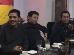 L to R : Chen Shaoxiong with curator Pi Li and artist Wang Gongxin at the celebration dinner of 'MAAP in Beijing' 2002.